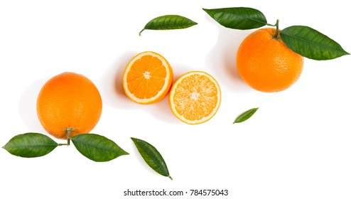 Top view of halves and wholes of orange fruits with leaves isolated on white background.