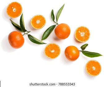 Top view of halves and wholes of tangerine fruits with leaves isolated on white background.