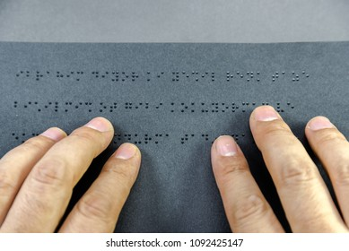 Top view of hand of a blind person reading a book written in braille alphabet for blind people. Istanbul,Turkey.10 February 2017