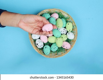 top view hand holding easter eggs