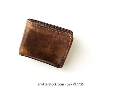 Top view hand made old leather wallet isolated on white background