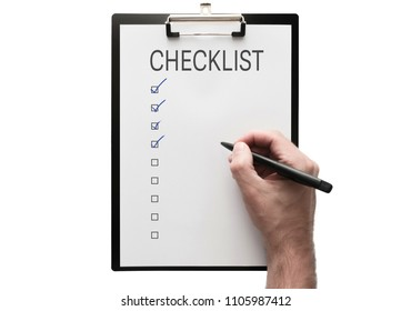 top view of hand with a pen on clipboard with checklist on white background