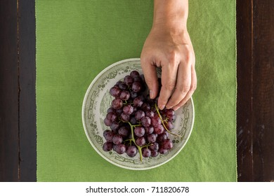 top view of hand picked grape in dish on the table