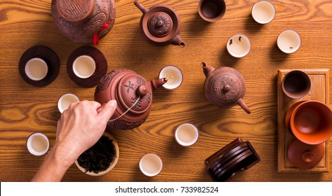 Top view of hand serving a chinese tea. Those Chinese character is a name of tea leave.