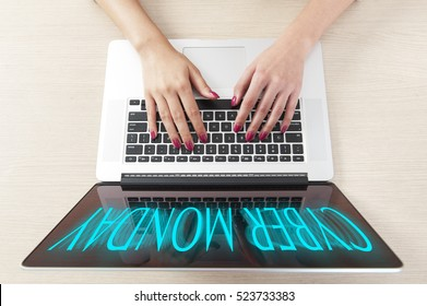 Top view of hand typing on laptop keyboard, Cyber Monday Shopping