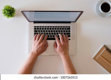 Top view hands using laptop computer, internet communication social media, working from home concept, Online shopping concept, for presentation product