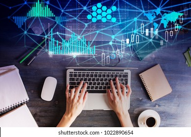 Top view of hands using laptop with abstract digital business interface. Technology, future and graph concept. Double exposure