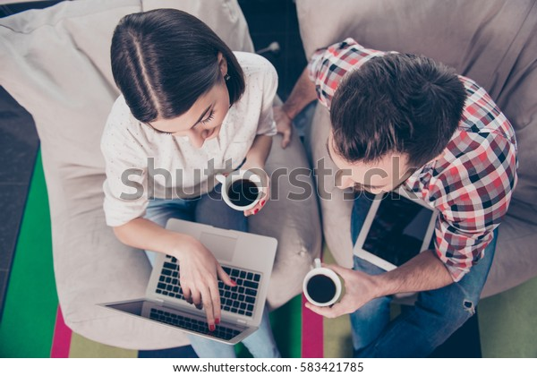 Top view of happy businesspeople working on modern laptop