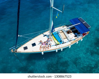 Top view of Happy family with adorable daughter and son resting on a big yacht