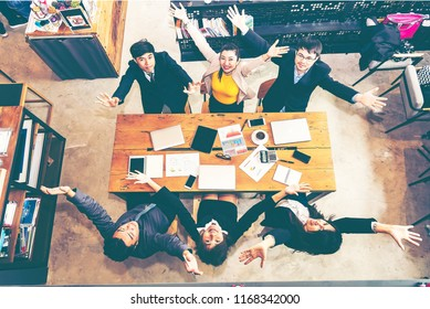 Top View Happy Startup diversity teamwork brainstorming meeting concept. Business young multiethnic team working and planning Start Up in modern office.