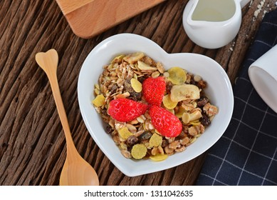 Top view of healthy breakfast with cereal and fresh strawberry in the love cup. Served with milk. Concept about love and relationship.Valentine Day with copy space