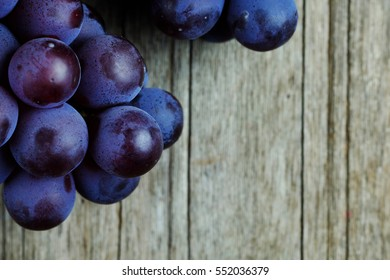 Top view of Healthy grape on wood table, selective focus and copy space.