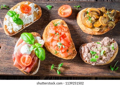 Top view of healthy mix of bruschetta with fresh ingredients