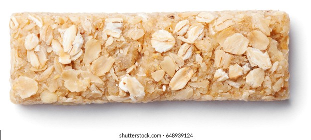 Top view of healthy oat granola bar (muesli or cereal bar) isolated on white background
