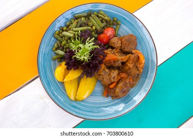 Top view of healthy vegetables with meat on the plate in the restaurant