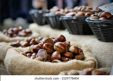 Top view heap of chestnuts. Pile of ripe chestnuts for food background.