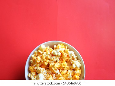 top view Heap popcorn caramel popcorn on red background
