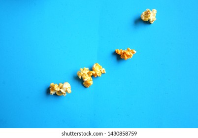top view Heap popcorn caramel popcorn on blue background