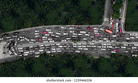 Top view of heavy traffic with motorcycles and cars on the highway at the peak hour