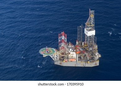 Top view of helicopter pick up passenger on the offshore oil rig.