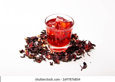 """top view of hibiscus infusion iced tea called """"Rosa de Jamaica"""" o """"aguas frescas"""" in Mexico and Central America, served on a glass isolated on white background."""