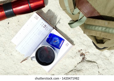 Top view of hiking tools on the rock.Concept of travelling, tramp in the mountains