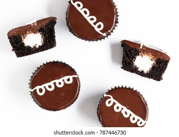 A top view of homemade copycat version of Hostess chocolate cupcakes on a white background.