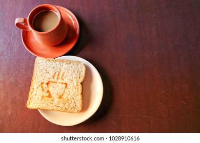 top view  homemade hot cappucino coffee with toast whole wheat bread on table wood background.