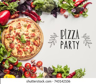 top view of homemade italian pizza on wooden board and fresh vegetables isolated on white