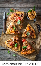 Top view of homemade pizza with noble mushrooms and tomatoes