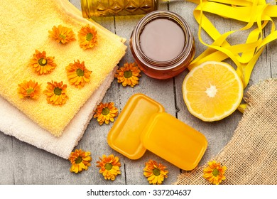 Top view of honey soap with lemon over wooden table