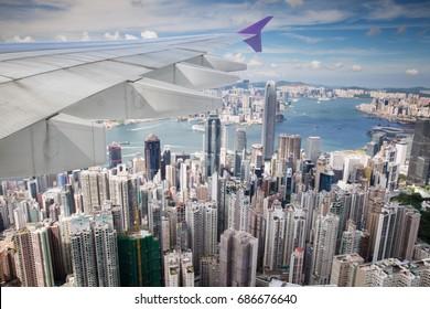 Top view of Hong kong, Kowlon and wing of airplane from window of airplane just take off from Hongkong international airport, Hongkong city, China