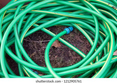 top view of hosepipe on grass, minimalistic conception