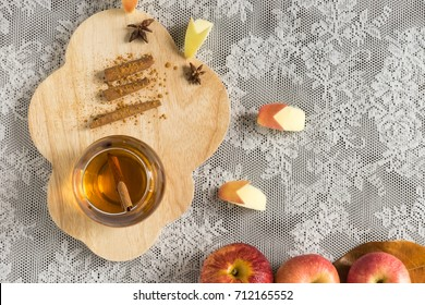 top view hot apple juice in glass with cinnamon. autumn food concept