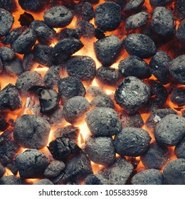 Top View Of Hot Flaming Charcoal Briquettes Glowing In The BBQ Grill Pit. Abstract Red Black Frame Background, Texture Or Wallpaper. Burning Coals For Cooking Barbecue Food. Close Up.