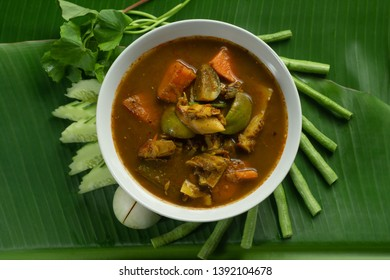 Top View of hot flavor  Southern Thailand soup And various vegetables of Asia on Green Banan Leaf.