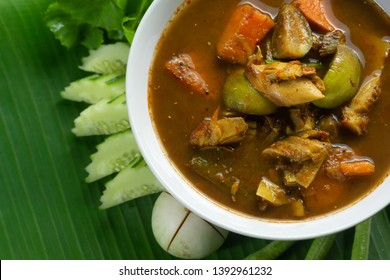 Top View of hot flavor  Southern Thailand soup And various vegetables of Asia on Green Banan Leaf. with Space for Text.