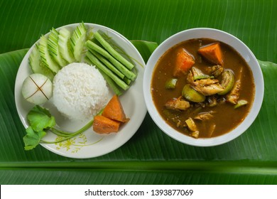 Top View of hot flavor  Southern Thailand soup And Cooked Rice with Various Vegetables of Asia on Green Banan Leaf.