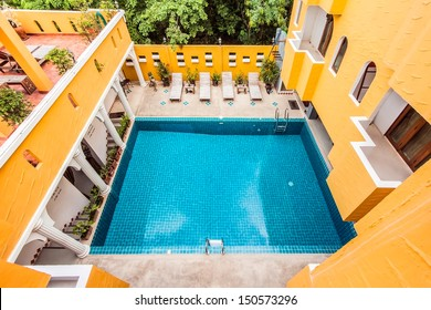 Top view of an hotel in Morocan styles that build swimming pool at the center