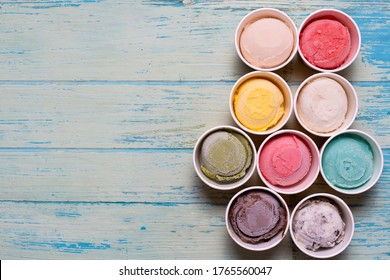 Top view of Ice cream flavors in cup and topping, sweet and dessert food concept