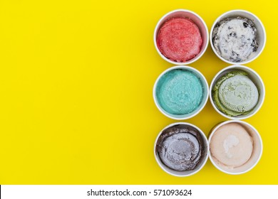 Top view Ice cream flavors in cup on yellow blackground