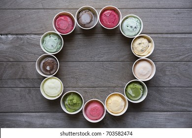 Top view of Ice cream flavors in cup and topping set in circle shape, sweet and dessert food concept