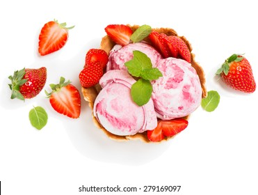 Top view of ice cream of strawberry in a wafer bowl  and fresh berry  isolated on white background