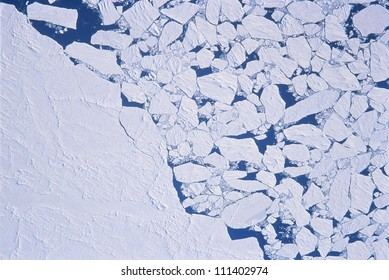 Top view of ice floes jammed to the shore