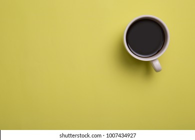 Top view image of coffe cup on yellow background. Flat lay. Copy space