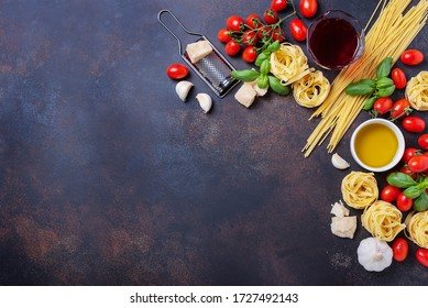 Top view image with a copy space of spaghetti, tagliatelle, tomato, basil, cheese, garlic and wine. Concept of a healthy Italian cooking