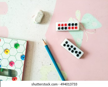 top view image of desk with kid supplies on wooden table. leisure  concept, Closeup