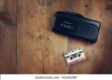 top view image of investigation concept. tape recorder and cassette. vintage filtered