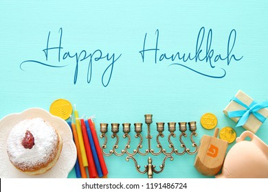 Top view image of jewish holiday Hanukkah background with traditional spinnig top, menorah (traditional candelabra) and candles