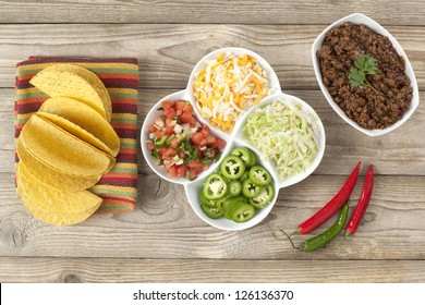 Top view image of mexican tacos ingredients on wooden board